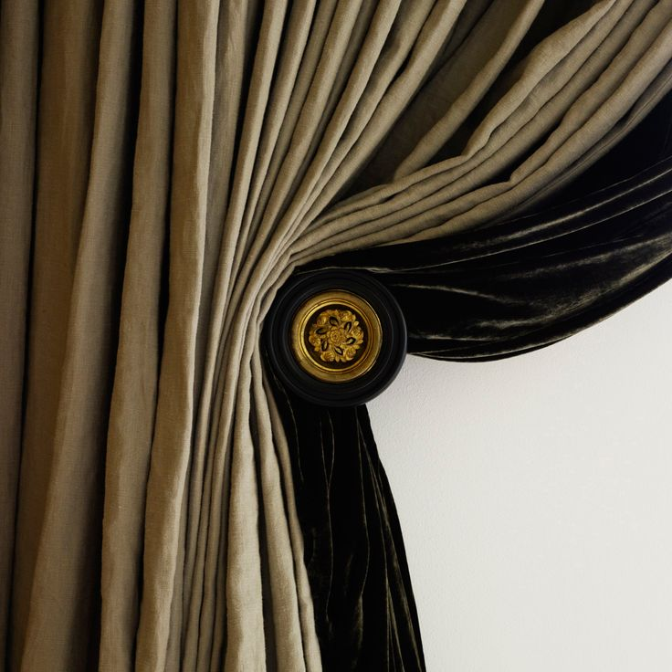 J O H N . M I N S H A W . silk and velvet curtains with stunning doorknob holdback.