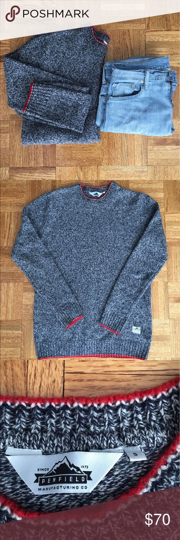 Penfield Men's Crew Neck Sweater 100% Lambswool. Blue/gray with red trim. Ribbing on the wrist and at the bottom of the sweater. Like new. Could also fit a female for a more relaxed fit. Jeans photographed are also for sale. Penfield Sweaters Crewneck