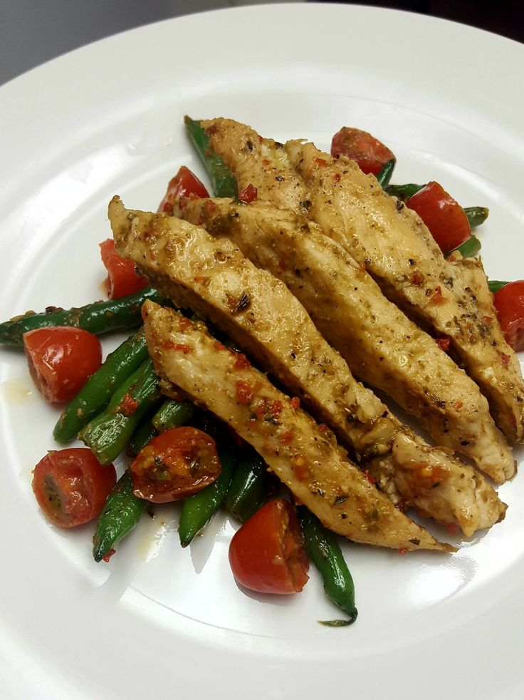 Pesto Chicken, green beans and cherry tomatoes; a meal you'll await with great anticipation.