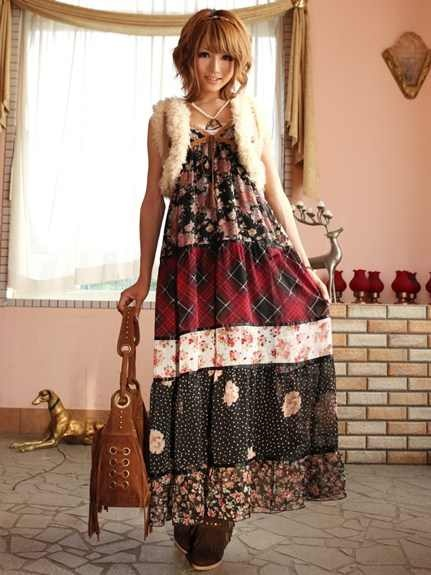 Hippie boho prairie patched quilt dress with mini faux fur vest. Suede fringe bag  boots.