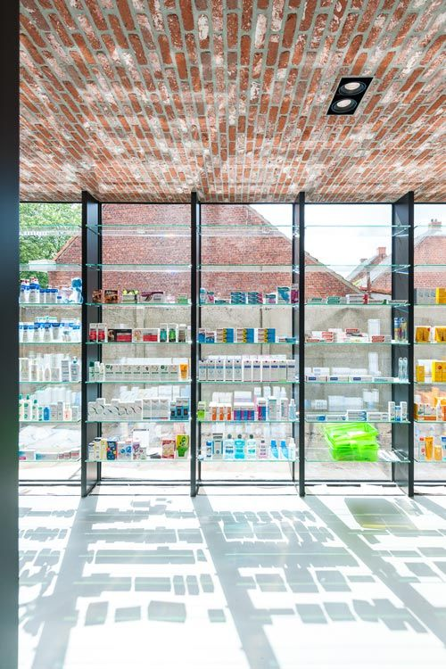NOTE: Dividers between shelving allowing beautiful products and pharmacy products to co-exist