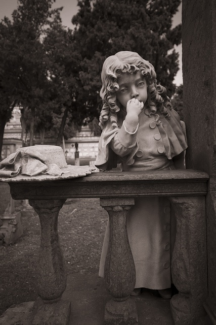 Cemetery of Bonaria - Magnificent statue for this beautiful shot. The sepia tone is great! Well done!