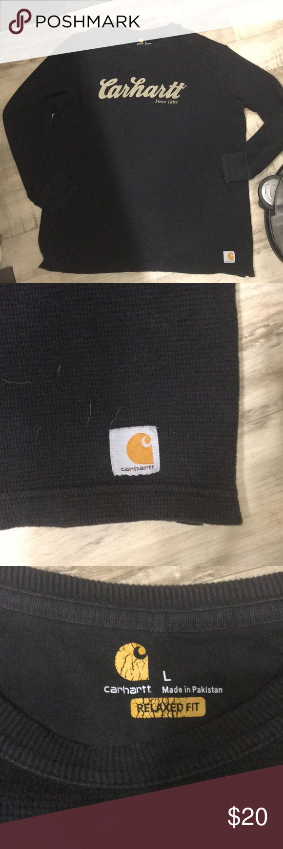 Carhartt relaxed fit thermal Size large. In great shape no holes or stains. Also no cracking on logo just mild cracking on tag logo on the inside. Carhartt Shirts