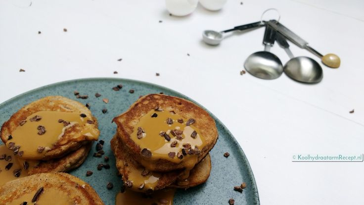 Pancakes with Caramel Sauce - eggs, almond milk, coconut flour, stevia/other sweetener, baking powder, gingerbread spices, salt, butter/ghee/coconut oil, Walden Farms caramel sauce, cocoa nibs, marscapone (optional, would omit or sub another cheese)