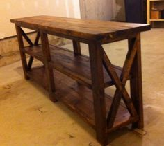 Rustic X Console | Do It Yourself Home Projects from Ana White - She calls this a starter project so it should be fairly easy.=