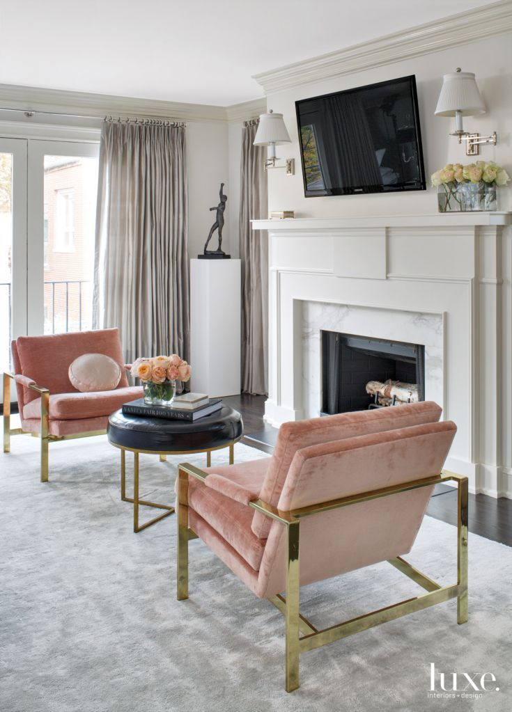 In the master bedroom's sitting area, vintage chairs designed by Milo Baughman are upholstered with a Pierre Frey linen-velvet from Holly Hunt and flank an Oly ottoman. A custom silver silk carpet by Labrum, fabricated by Direct Rug Import, plays off silver silk draperies from Fabricut.