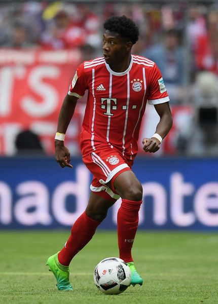 David Alaba of FC Bayern Muenchen controls the ball during the Bundesliga match between Bayern Muenchen and SC Freiburg at Allianz Arena on May 20, 2017 in Munich, Germany.