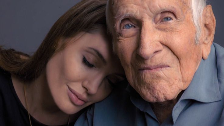 Angelina Jolie's 'Unbroken' hero was her neighbor all along. This movie is coming out on Dec. 25th 2014!!!!!
