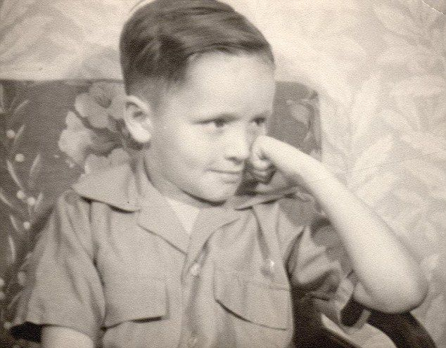 Portrait of a killer: Charles Manson, age five, in a never before seen picture taken just before his first day at elementary school. His dim...