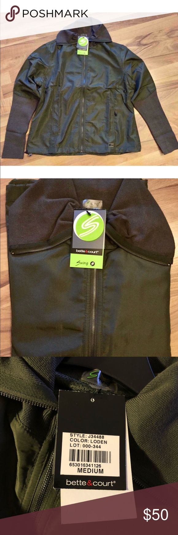 """NWT Olive green """"Swing"""" ladies golf jacket. Med. Not just for golf...made for women w/active lifestyles. See tag for item description. Adorable in Style. New with tags...never worn. Ladies Medium-runs true to size. 100% Polyester. Machine washable. Jackets & Coats Utility Jackets"""