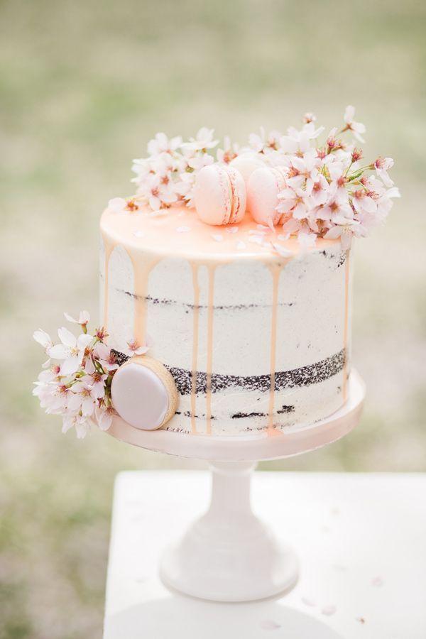 wedding cake topped with cherry blossoms - photo by Elisabeth Van Lent Photography http://ruffledblog.com/cherry-blossom-garden-wedding-ideas/