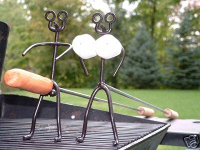 Man & Woman Hotdog & Marshmallow roasting sticks - Suggestive of Bonding Unions in Transautumn (human breeding season)