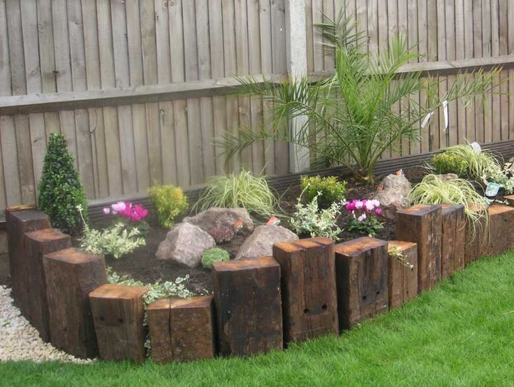 cut railroad ties & use like this - MUCH more interesting Raised-Bed-1.jpg (904×681)