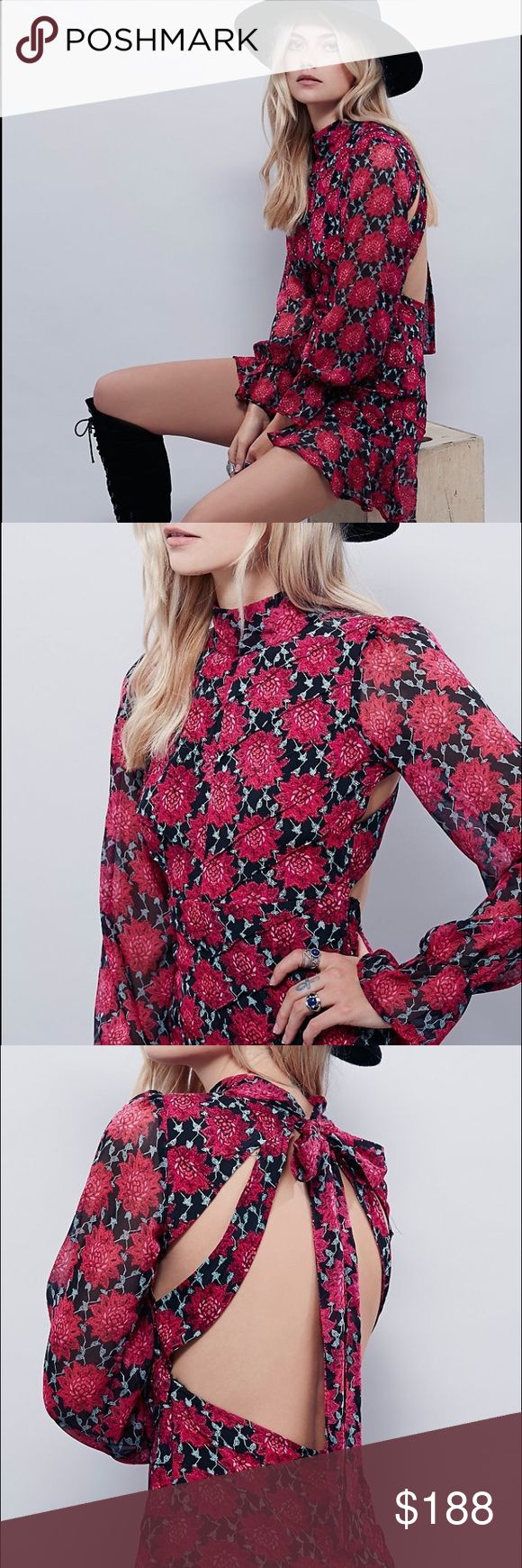 """For Love And Lemons Clover Mini Floral Dress Semi-sheer magenta/black/mint floral print mini dress by the brand """"For Love And Lemons"""". Features a mock neck. Open back with cut out details and ties at back of the neck. Darting textured seam lines throughout. Slightly flared/ruffle sleeve cuffs. Side zip closure. Made from rayon and polyester fabrics. Women's size small. This piece is new without tags, as I have never ended up wearing it. This is in excellent condition. For Love and Lemons…"""