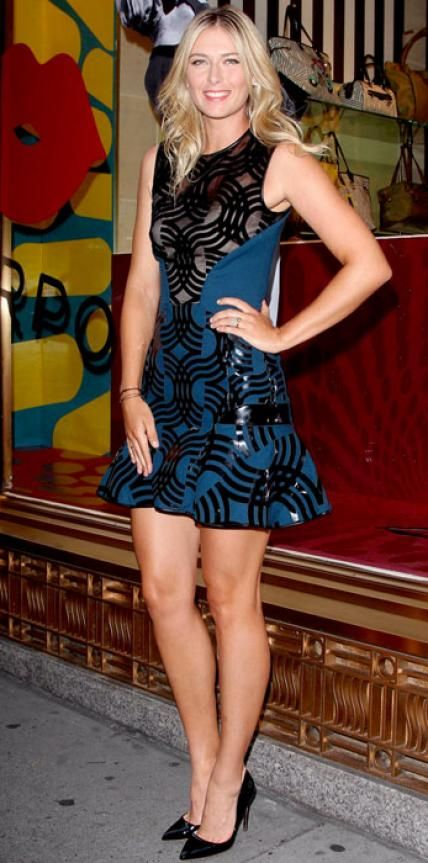 Look of the Day › August 21, 2013 WHAT SHE WORE Sharapova launched her Sugarpova accessory collection in a black-and-blue mini David Koma dress with leather detailing and a ruffled hem, pairing it with black patent Rupert Sanderson pumps.