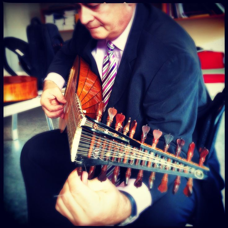 Musician and magician Rafael Benatar tuning the barque lute for Compositions.  Photo: Julie Eng.