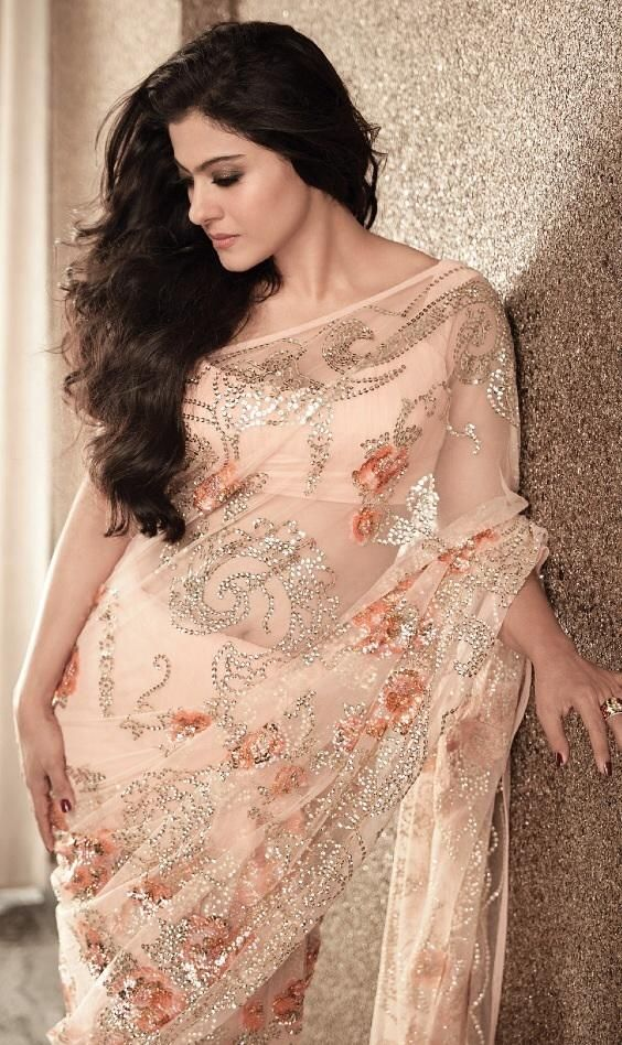 Kajol in a peach colour saree or sari and blouse