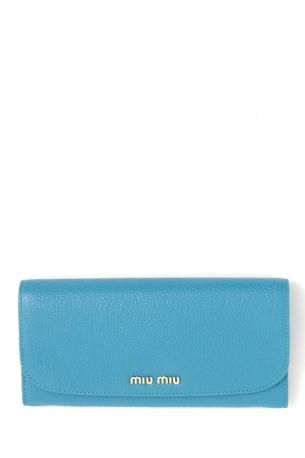 Miu Miu long flap leather wallet turquoise. Leather wallet in light blue - turquoise color with snap closure. Inside casholdre, purse and card holders. Miu Miu Spring Summer 2013 Collection.    Height: 9,5 cm. Width: 19,5 cm. Depth: 2 cm.
