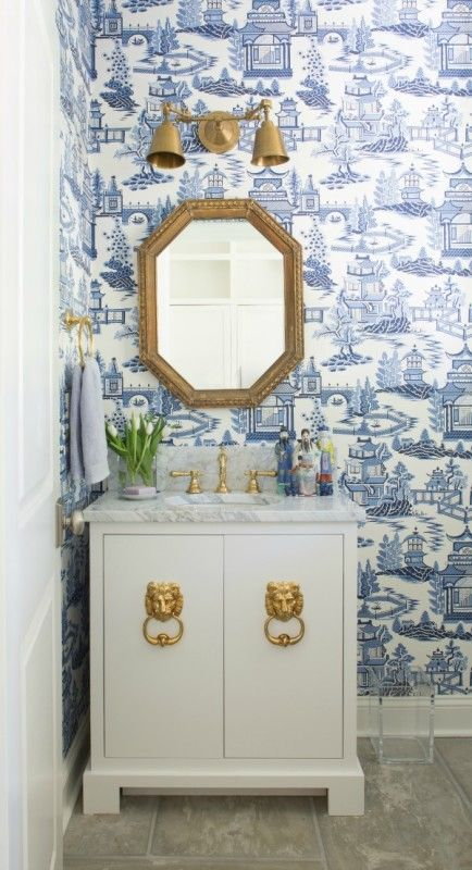 This downstairs powder room blends elements Jenna loves, including brass hardware and blue-and-white accents. Chinoiserie wallpaper packs a big design punch in a small space.