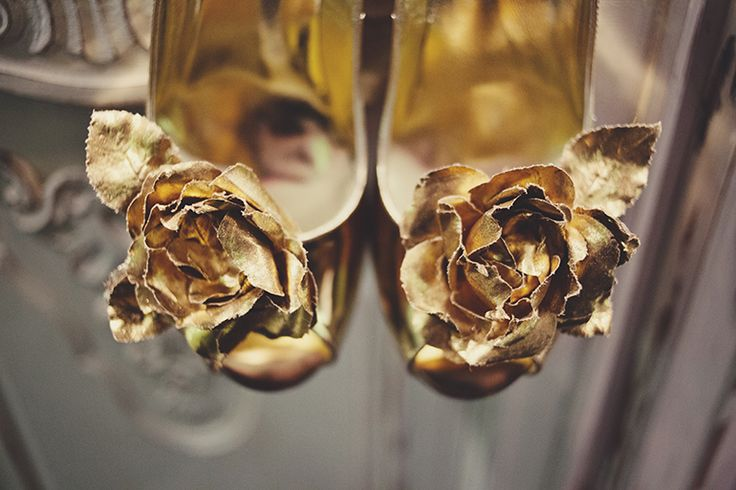 This beautiful opulent Gold rose with leaf petals is a limited edition to the Freya Rose collection. Hand made by our couturier flower make in Paris. It is made in gold leaf material that is over 100 years old. There is only a small amount of this material  left, once gone, gone forever.    http://freyarose.com/All-shoes/shoe-clips/Klimpts-Rose