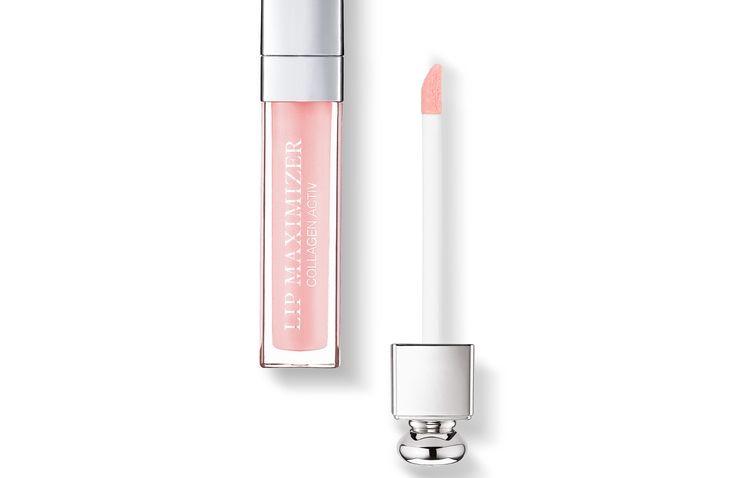 """Dior.com DIOR ADDICT LIP MAXIMIZER Der erste Gloss für sofort mehr Volumen aus dem Dior Backstage-Bereich. Dior Addict Lip Maximizer versorgt die Lippen mit Feuchtigkeit und sorgt im Nu für unglaubliches Volumen - für einen """"glossy"""" Look mit vollen Lippen, wie aufgefüllt und verwandelt. Der Minz-Vanille-Duft sorgt für ein frisches, angenehmes Gefühl."""