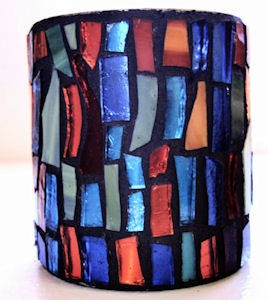 This is a tin can with glass mosaic on it. I wonder if I could do this and put two handles on it - broken off from old mugs and make it into a washing cup.