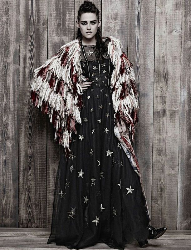 Who What Wear Blog Kristen Stewart Metiers D'Arts Paris Dallas Pre Fall 2014 Campaign Photographer Karl Lagerfeld Western Inspired Cowgirl Looks Style Corn Rows Hair SMokey Winged Eyes Beauty Fringe Tiered Coat Star Print  Maxi Dress