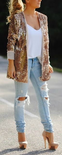 Glitter & distressed denim. The blazer is a little much for me and I would prefer a darker jean, but I like the concept. And I love her ponytail and heels!