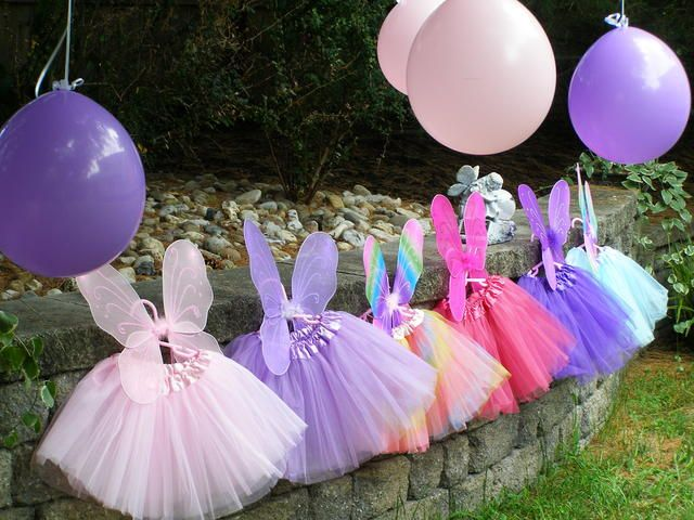 Tutus and fairy wing favors at a Fairy Party #fairyparty #favors  What child wouldn't love this.  Tutut's are so easy to make just look up youtube how to do.   2 yards of tule.