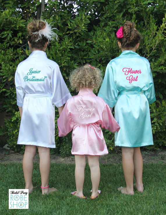 Set of 3 Girls Satin Robes with Title or Name Embroidered on the Back  You cant forget the Flower Girl, Junior Bridesmaid and other tiny ones in your bridal party. Our kids satin robes are perfect for the Flower Girls, Junior Bridesmaids, and all the little ones joining you on your big day!  Our satin kids robe fit girls from age 2 to 12. This personalized satin robe comes with the title or custom wording of your choice across the back. Choose from over 45 thread colors. ABOUT US & OUR ROBES…