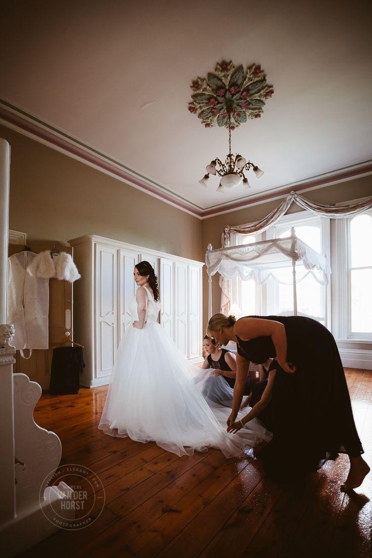 Vintage wedding dress, Red rose bouquet bride portrait Melbourne Wedding & Commerical Photographer Marcel Van der Horst Melbourne Wedding & Commerical Photographer Marcel Van der Horst