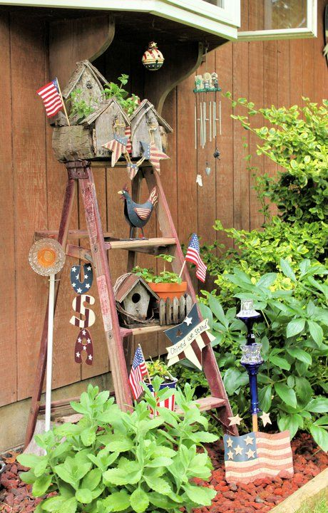 I've been trying to figure out how to incorporate my old ladder.  love this.  I would put hanging flower basket inside the middle though!