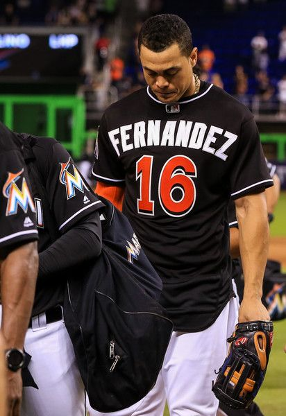 Giancarlo Stanton walks off the field after the game against the New York Mets at Marlins Park on September 26, 2016 in Miami, Florida. The entire Miami Marlins team wore Jose Fernandez jerseys in honor of the late pitcher.