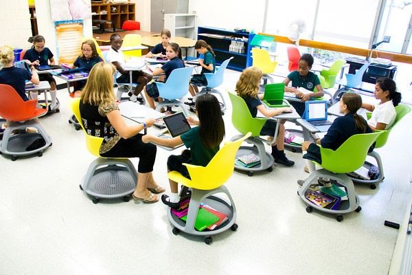 """""""A Future Classroom has been outfitted in the Math wing. This prototype classroom is filled with brightly colored Node chairs which are not only fun but are designed to take advantage of our iPad technology and are versatile tools that allow for flexibility in the classroom."""""""
