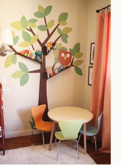 Tree painted on wall with small shelf as limb
