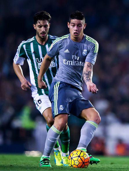 James Rodriguez of Real Madrid CF competes for the ball ahead Alvaro Cejudo of Real Betis Balompie during the La Liga match between Real Betis...