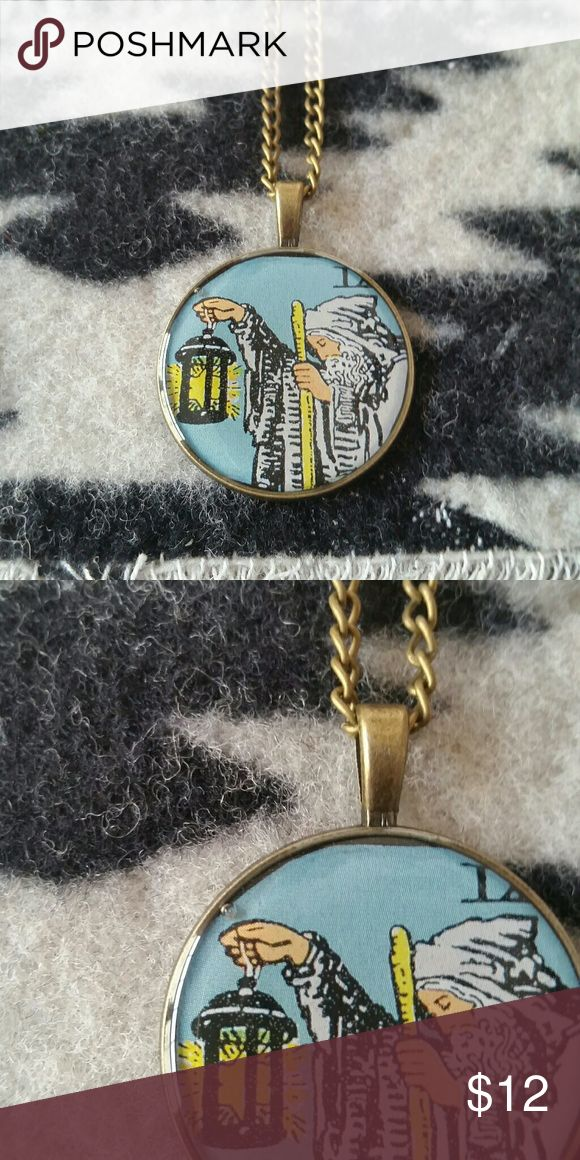 """Handmade 'The Hermit' Tarot Rider-Waite Necklace Lovingly handmade by yours truly, this is a cabochon necklace featuring The Hermit tarot card from the Rider-Waite deck. There is a single bubble in the epoxy, shown in the second photo, though it is hardly noticeable. It is on a 18"""" bronze tone chain with a lobster closure. All metals are nickel free. Tagged FP for exposure.   I have this item for sale on Etsy as well for slightly less in both cost + shipping, since fees are lower. However…"""