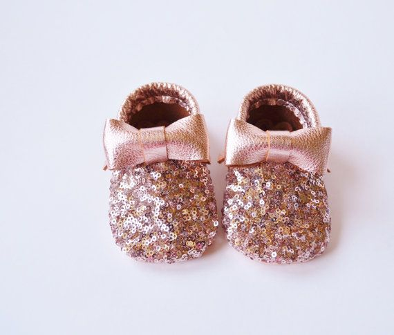 Copper Rose Gold Sequin Moccasins. ➕ PLEASE PLEASE PLEASE MEASURE YOUR CHILDS FOOT. SIZES ARE IN INCHES AND AGE APPROXIMATES ONLY. ▫How To Measure ▫ Trace your childs foot on a piece of paper and measure for best sizing results. Measure the tracing and add 1/4 to 1/2 inch. Order the size in the drop down sizing option that closest corresponds to your total measurement. Custom wide and narrow orders welcome!!! But please put childs exact measurement in the notes to seller or contact us before…