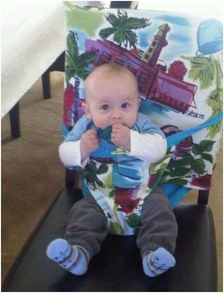 Portable fabric high chair for use at dinnertime anywhere