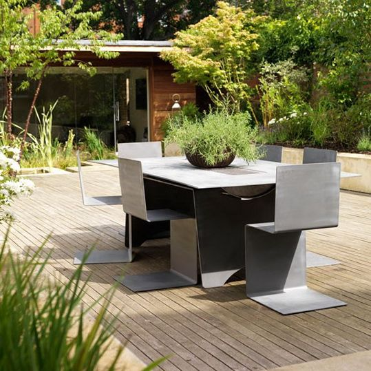 The landscaping and modern furniture look really great!