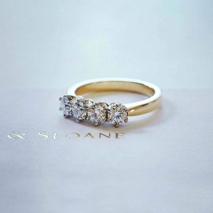 A bespoke four stone diamond band. Naveya & Sloane wedding band, made to order in Auckland, New Zealand.