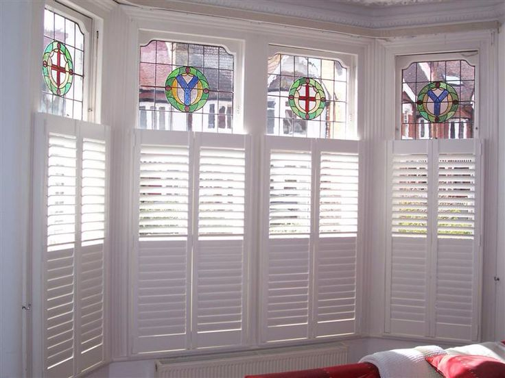 Cafe style, don't want to spoil the beautiful leaded work. Www.apollo-blinds.co.uk