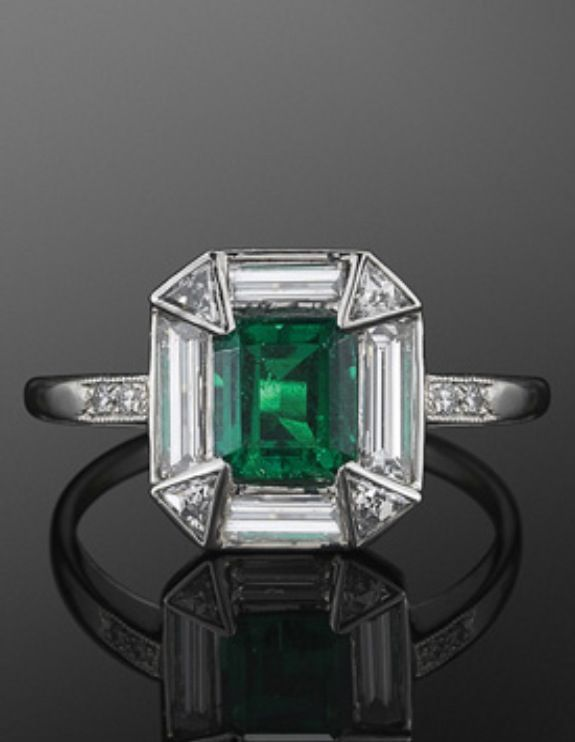 A Platinum Columbian Emerald & Flawless Diamond ring from the period.