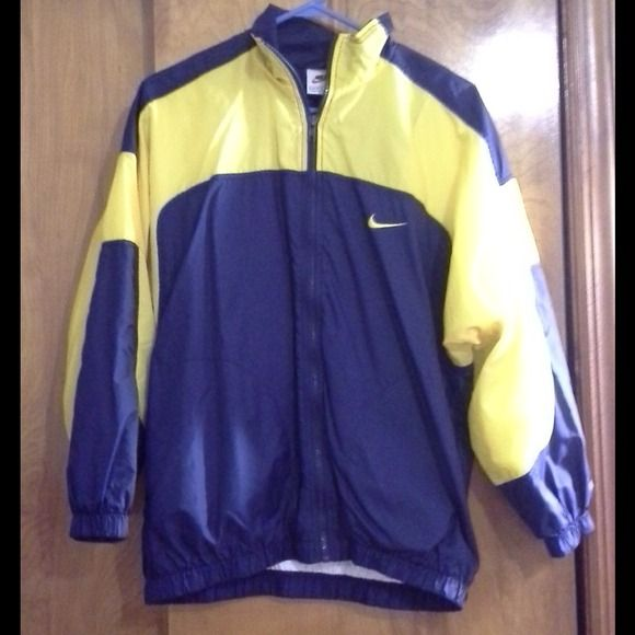 Nike waterproof jacket Nike waterproof jacket. Size L but more for a Small and Medium size. I'm a small and it fits perfectly. Gently worn and in good condition  Especially good for runners, wear it on top of your tank and shorts on the track, rain or shine. Nike Jackets & Coats