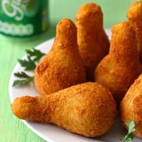 Coxinha de frango is a Brazilian drumstick shaped fritter based on a mixture of shredded chicken that is wrapped in dough, then battered and deep-fried.