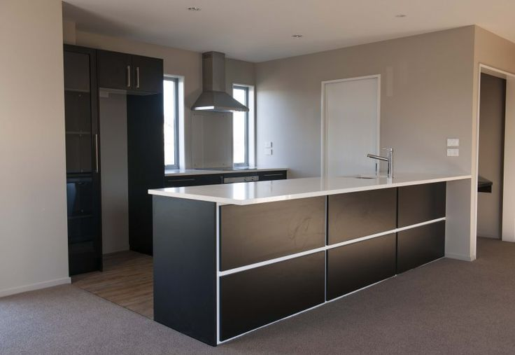Versatile Homes and Buildings kitchen in a home in Christchurch, featuring decorative panelling under the island bench