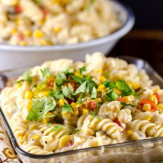 This Green Chile Chicken Pasta is a rich Southwest style pasta dish with green chilies and corn that makes a weeknight meal or an impressive gourmet dinner.