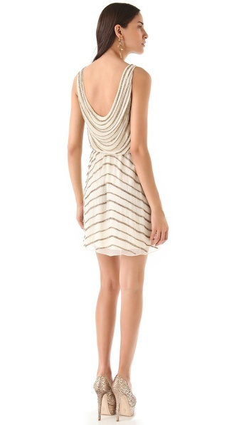 sleeveless alice + olivia dress with a gracefully draped bodice