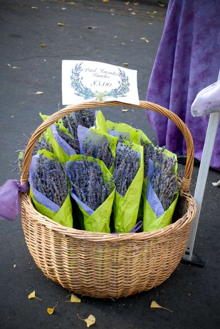Lavender at our farmer's market   (Cute idea...love the contrast of lime tissue with lavendar!) The signage works perfect at the top of the basket.