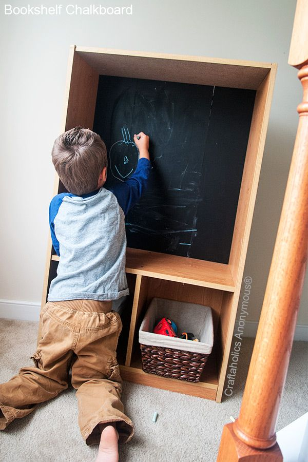 Love this bookshelf turned into a chalkboard art center!